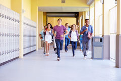 group high school students running corridor towards camera smiling 41525110